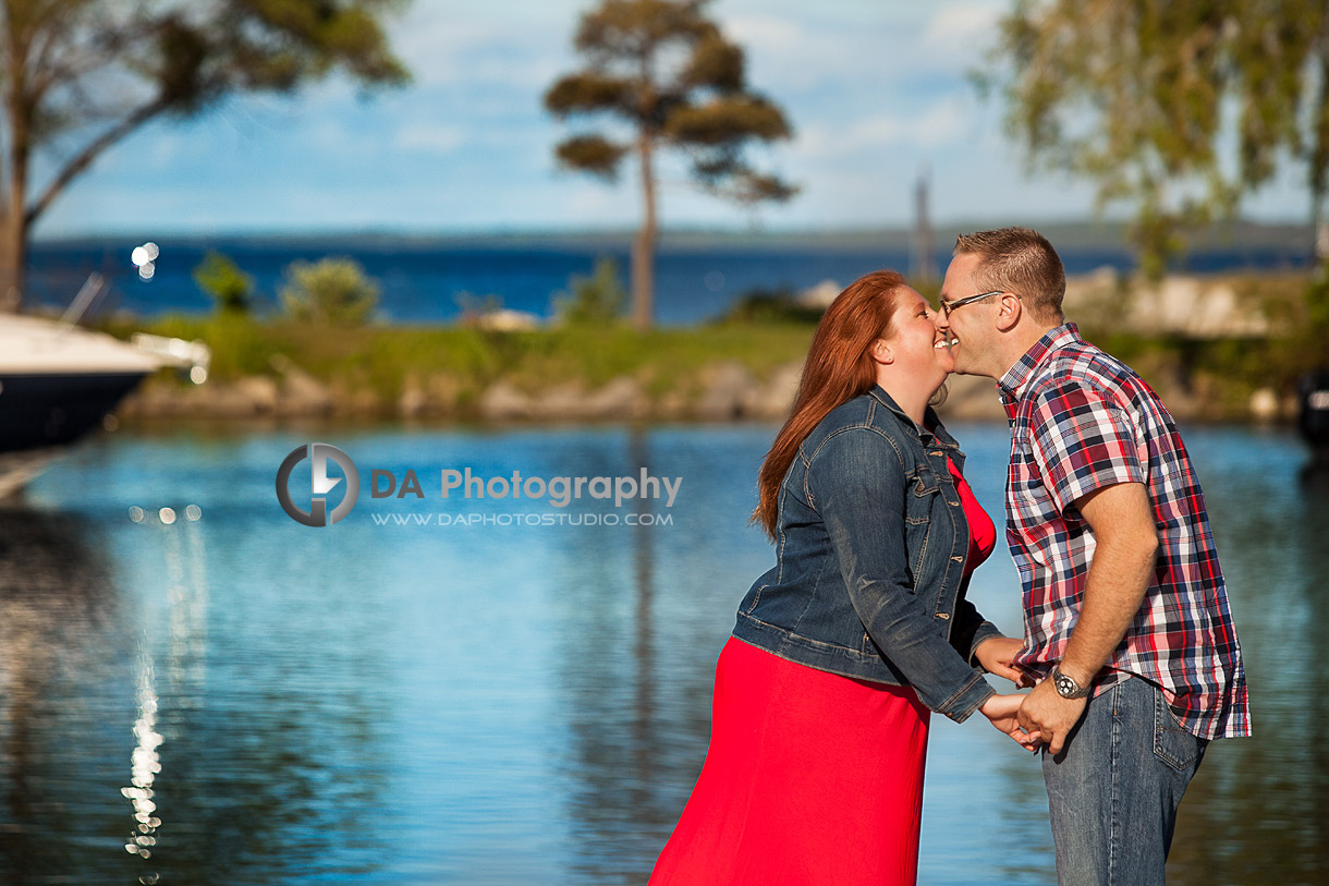 Engaged Couple's Kiss at the Waterfront in Barrie - Family Photography by Dragi Andovski - Barrie, ON