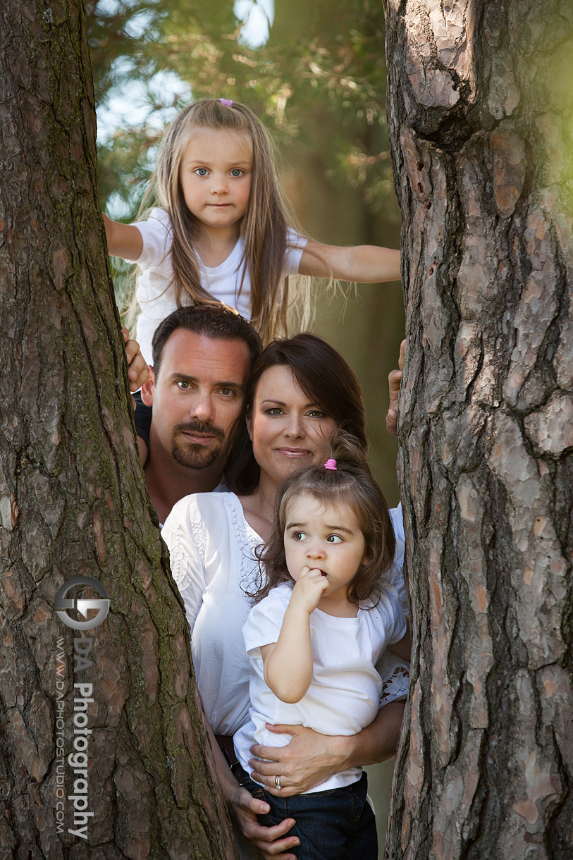 Family portrait by the tree - at Gairloch Gardens, Oakville by DA Photography , www.daphotostudio.com