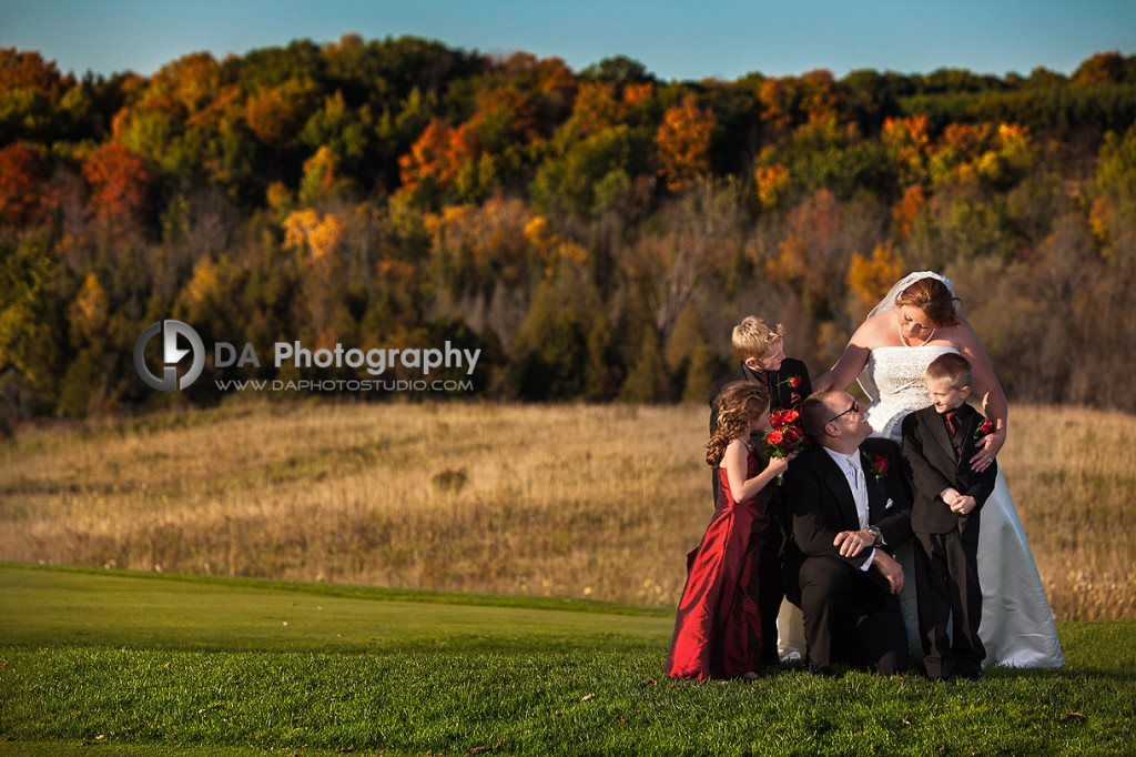 Happy Family on their parents wedding day - Blended Family in Fall wedding by DA Photography, www.daphotostudio.com