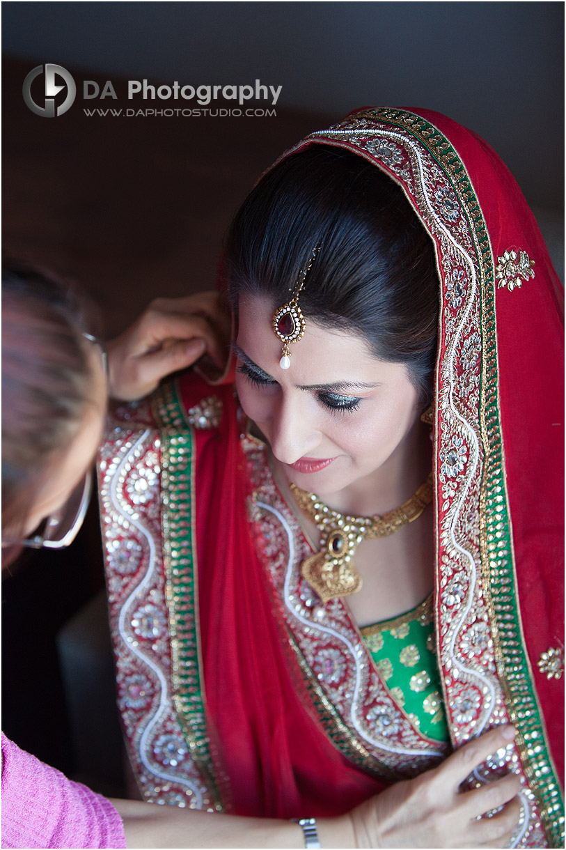 Bride's traditional Indian dress on her wedding day at Grand Empire in Brampton