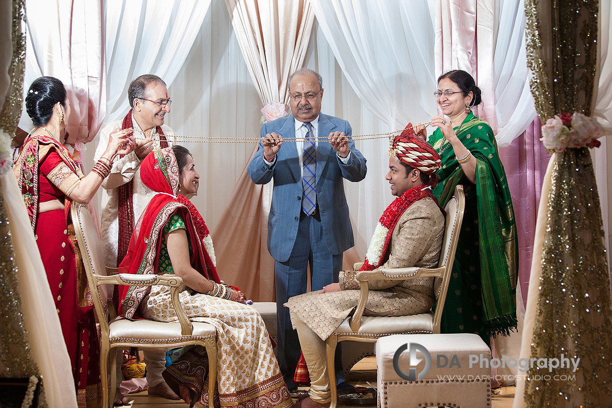 Parents involved in Hindu Indian Wedding Ceremony at Grand Empire Banquet Hall in Brampton