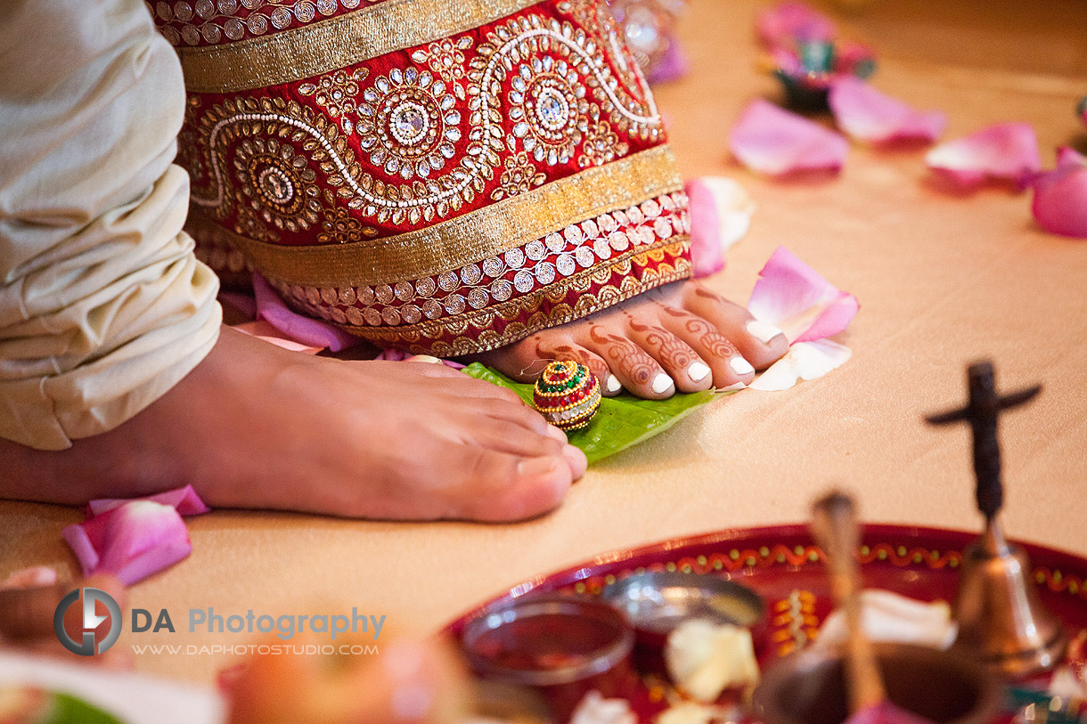 Bride & Groom's first step as a huband and wife on Hindu Indian Wedding Ceremony at Grand Empire Banquet Hall in Brampton
