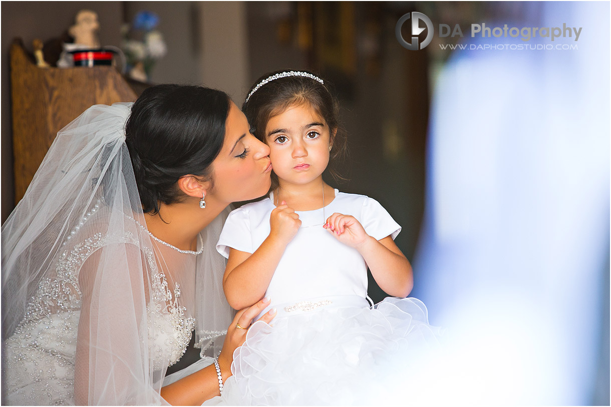 Bride with her flower girl on a wedding day