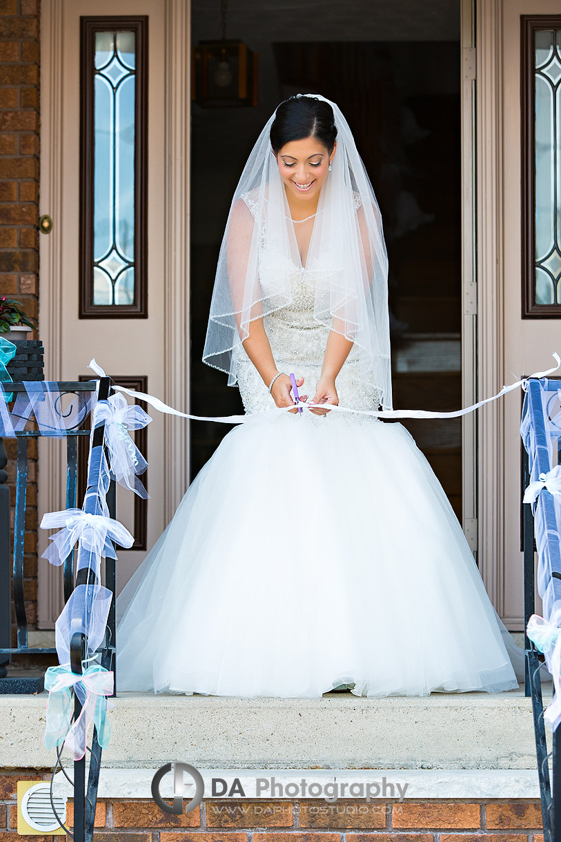 Bride exiting her house on a Italian Style Wedding