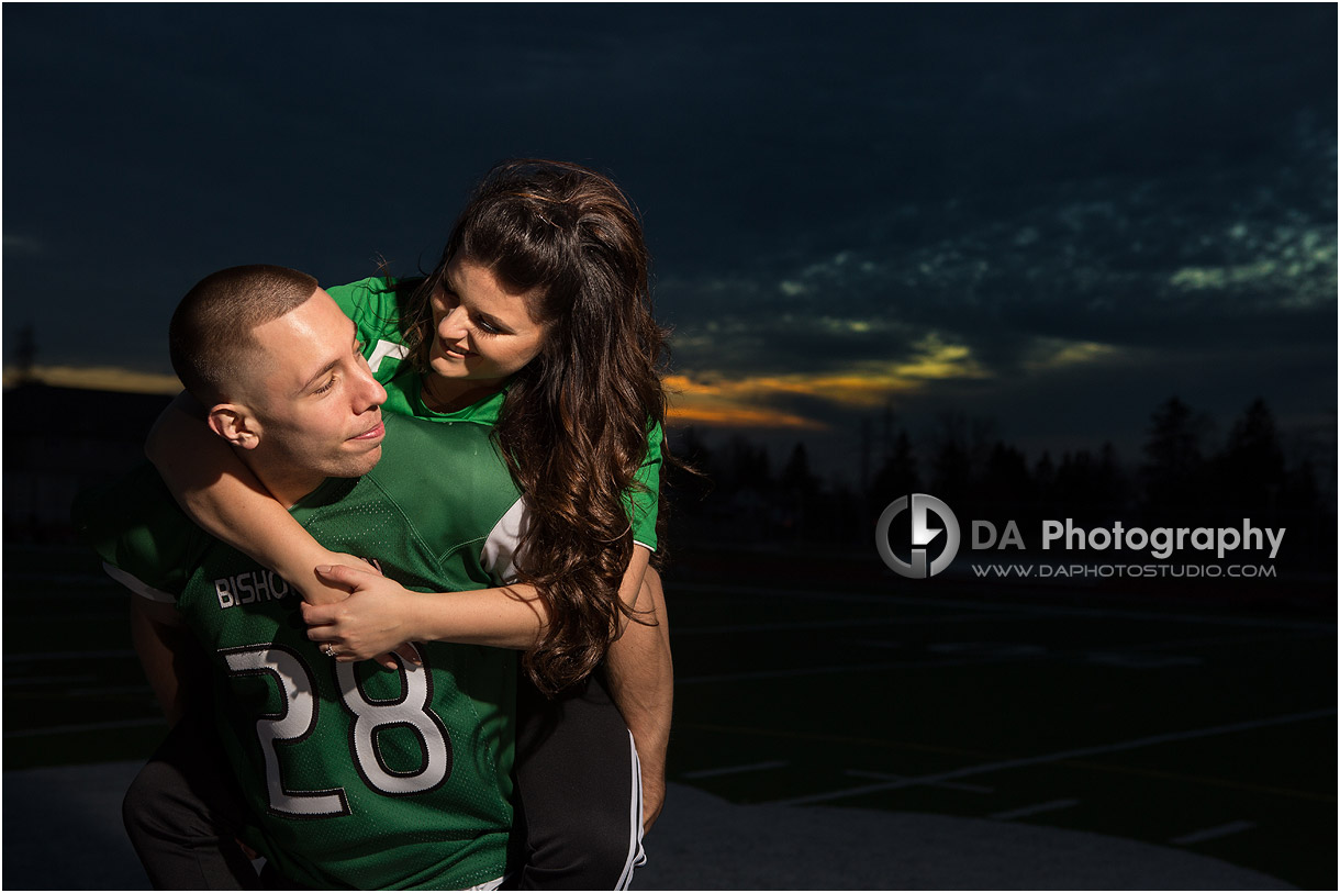 High school engagement in Hamilton on a football field
